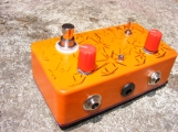 A Kay Fuzztone. Modified from the corrected original schematics, substituting equivalent modern transistors and improving the input filter to better deal with radio interference common to San José. The fuzz control is wired to a switched expression pedal jack, allowing for operation that's closer to the original pedal, as well as a standalone box without it. I also modified the clipping section to offer both symmetric silicone clipping, as well as asymmetric clipping by way of an additional green LED added to the circuit via switch. Ala the color, I think I almost managed to match the repulsive hue of the original. Almost.