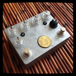 "Another experimental 2-in-one combining the vibrato circuit and the 4-transistor fuzz off the ""secret menu"" - not to mention another attempt at using up the epoxy. It'll happen, I swear. At the moment, this guy lives in Sweden."