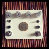 Custom Pedal 54, combining an Interfax Harmonic Percolator with a Gold Standard.