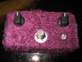The first functioning prototype of a simple overdrive circuit I'm working on that sits somewhere between a boost and a mild harmonic distortion, albeit with a coat of winter purple. This particular model currently resides with J Mascis, noted for his love of purple and little furry creatures, among other things.
